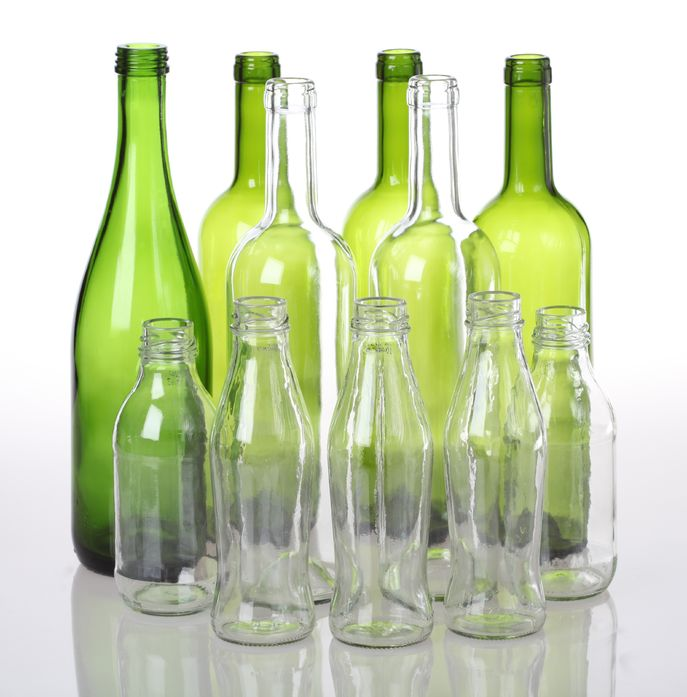 empty glass bottles for recycling on isolated background