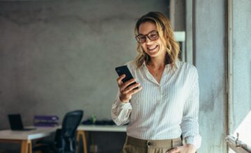 Female businessperson smiling at phone
