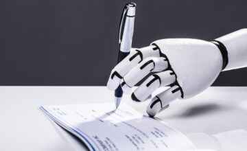 Robot hand signing cheque