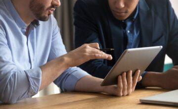 Demonstrating digital table to staff member